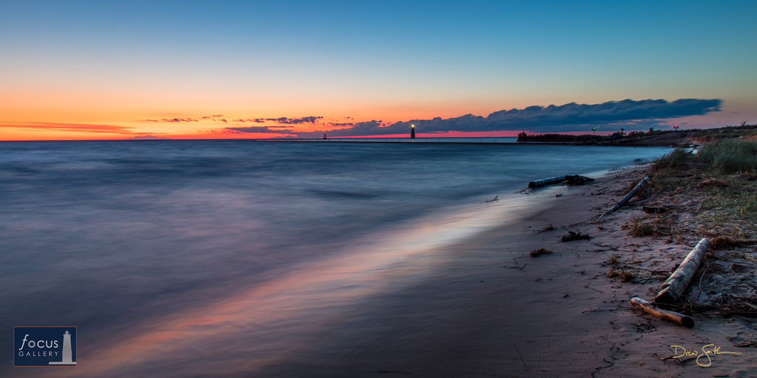Photo © Drew Smith Daylight fades as waves roll in from Lake Michigan looking towards Frankfort harbor and the piers.