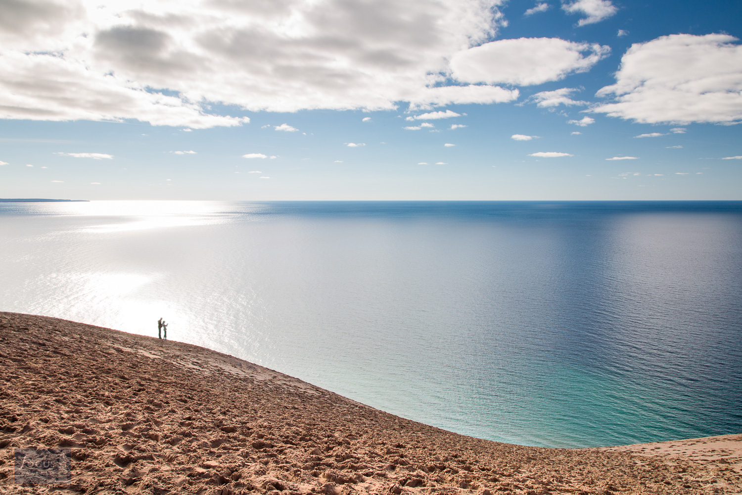 Photo © Drew Smith A couple of visitors take in the epic views at the Lake Michigan Overlook on the Pierce Stocking Scenic Drive...