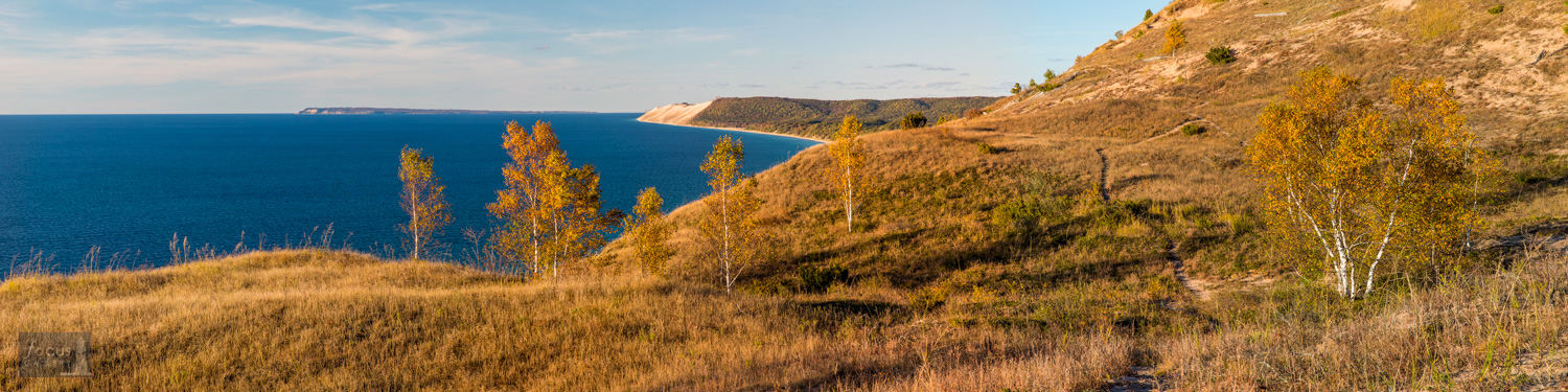 Trail through dunes with sweeping views of Lake Michigan and Sleeping Bear Dune.