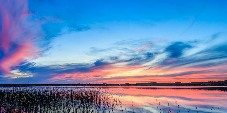 Beautiful sunset over Upper Herring Lake in Benzie County, Michigan.