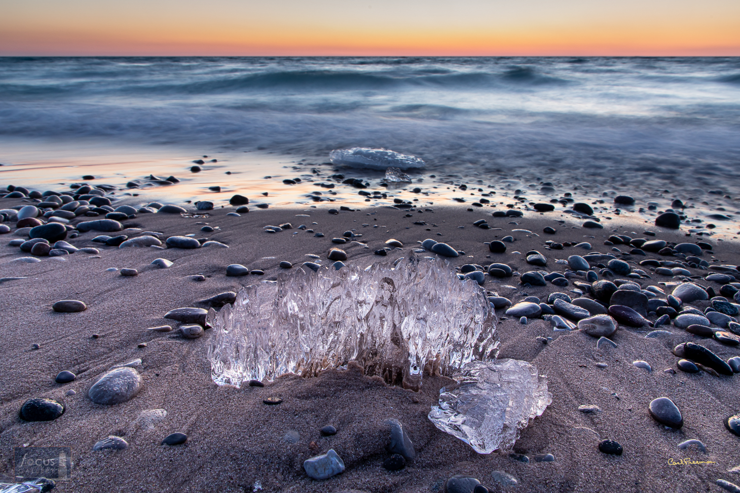 Photo © Carl Freeman When the shore ice along Lake Michigan melts and breaks, small pieces float around, get sculpted by the...